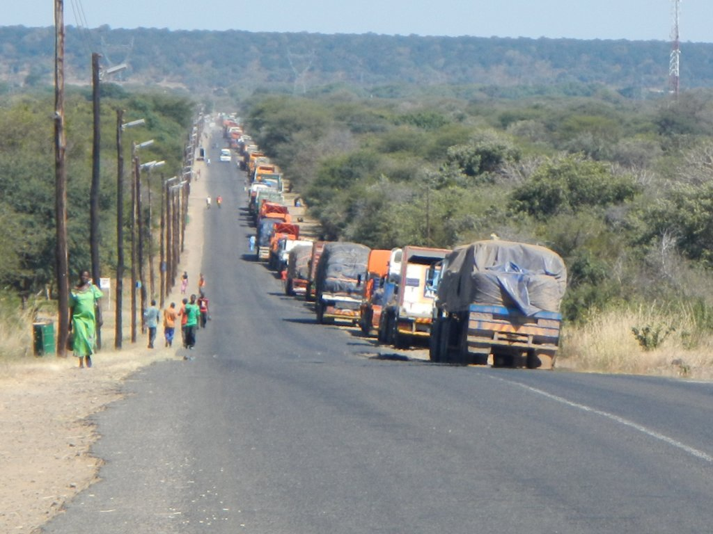 Trucks waiting to cross with the ferry into Botswana.