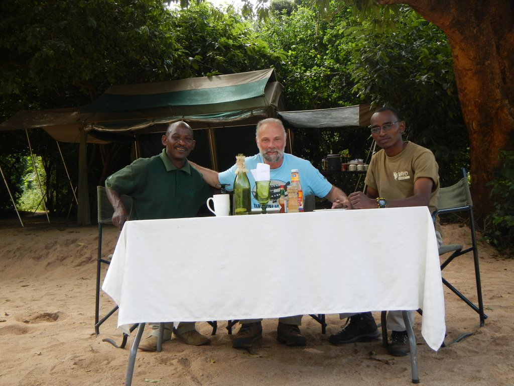 Seti , who cared for my every need in camp and my trusted guide Chris .
