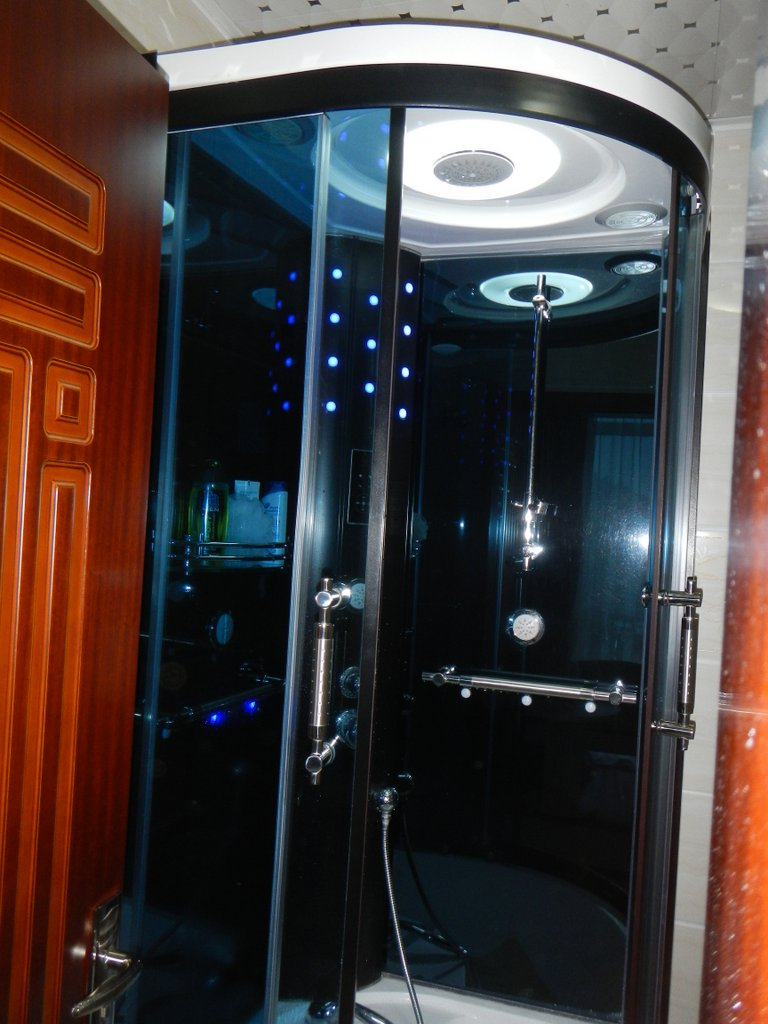 Never have I had a shower like this , the lighting of a night club with piped music while washing.